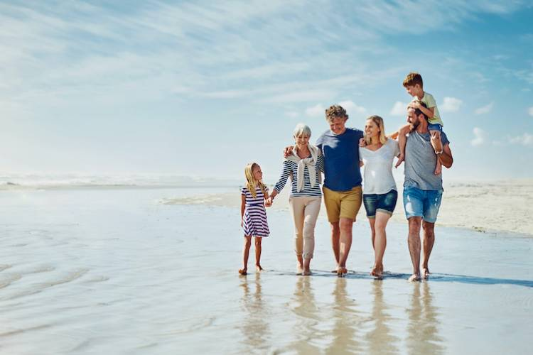 multi generational family on the beach